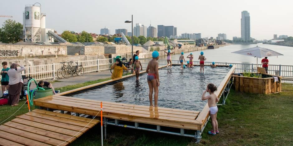 La piscine en plein air attire beaucoup de monde la dh for Piscine ouvert le dimanche