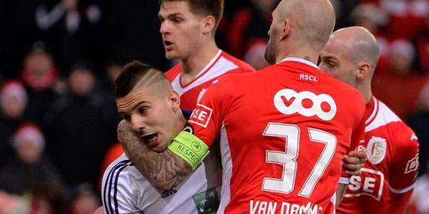 LIEGE, BELGIUM - DECEMBER 22: Aleksandar Mitrovic of Rsc Anderlecht - Jelle Van Damme of Standard Liege during the Jupiler League match between Standard Liege and RSC Anderlecht on December 22, 2013 in Liege, Belgium. (Photo by Peter De Voecht - Vincent Kalut / Photonews