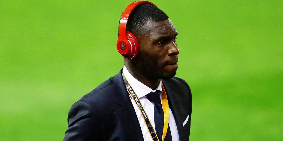 Christian Benteke of Liverpool arrives ahead of the UEFA Europa League Round of 16 First Leg match b