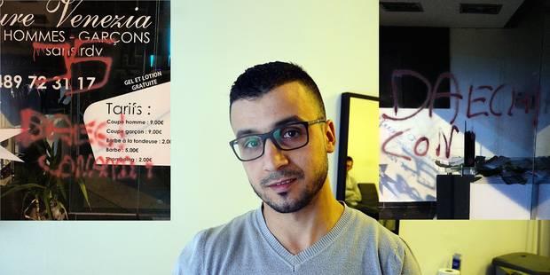Attentats de Bruxelles: un tag scandaleux sur la devanture d'un coiffeur - La DH