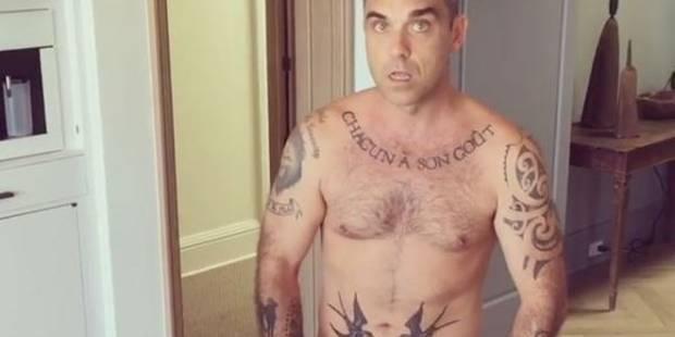 Robbie Williams se balade entièrement nu avec un gateau, filmé par sa femme - La DH