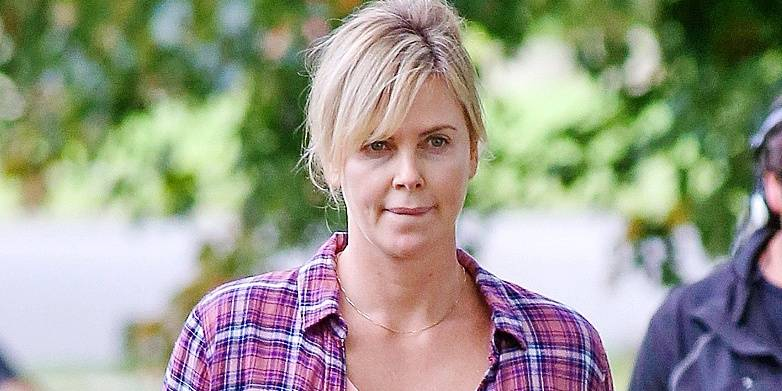 Charlize Theron puts her mothering skills to work while on the set of 'Tully'