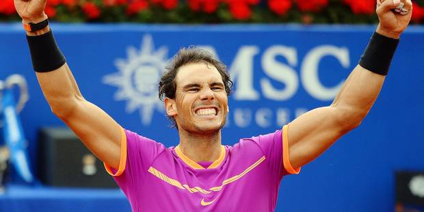 "TOPSHOT - Spanish tennis player Rafael Nadal celebrates his victory over Austrian tennis player Dominic Thiem at the end of the ATP Barcelona Open ""Conde de Godo"" tennis tournament final in Barcelona on April 30, 2017. Nadal won 6-4, 6-1. / AFP PHOTO / Josep LAGO"